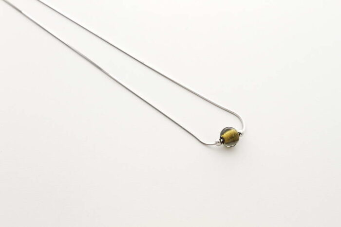 Glass and gold leaf necklace, steel gold